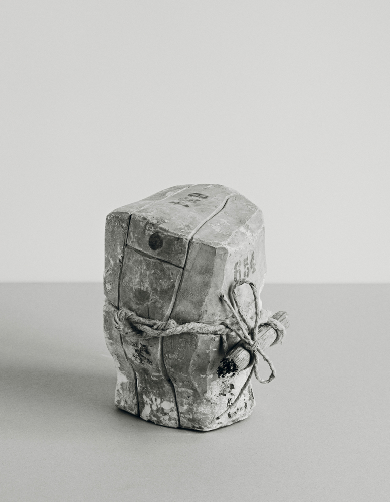 Johannes Wald, Broken Entity (Head of Herakles, 3rd century B.C., bronze, h. 11 cm, destroyed) 2016, silver gelatin print 73.7 x 57.8 cm unique work / Courtesy Daniel Marzona Gallery